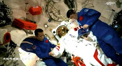 Astronauts Tang Hongbo and Liu Boming at work on China's space station