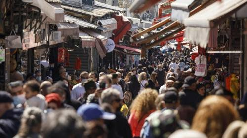 Crowds at Carmel market Tel Aviv last week. Israelis have been celebrating a post-pandemic rebirth since restrictions were eased