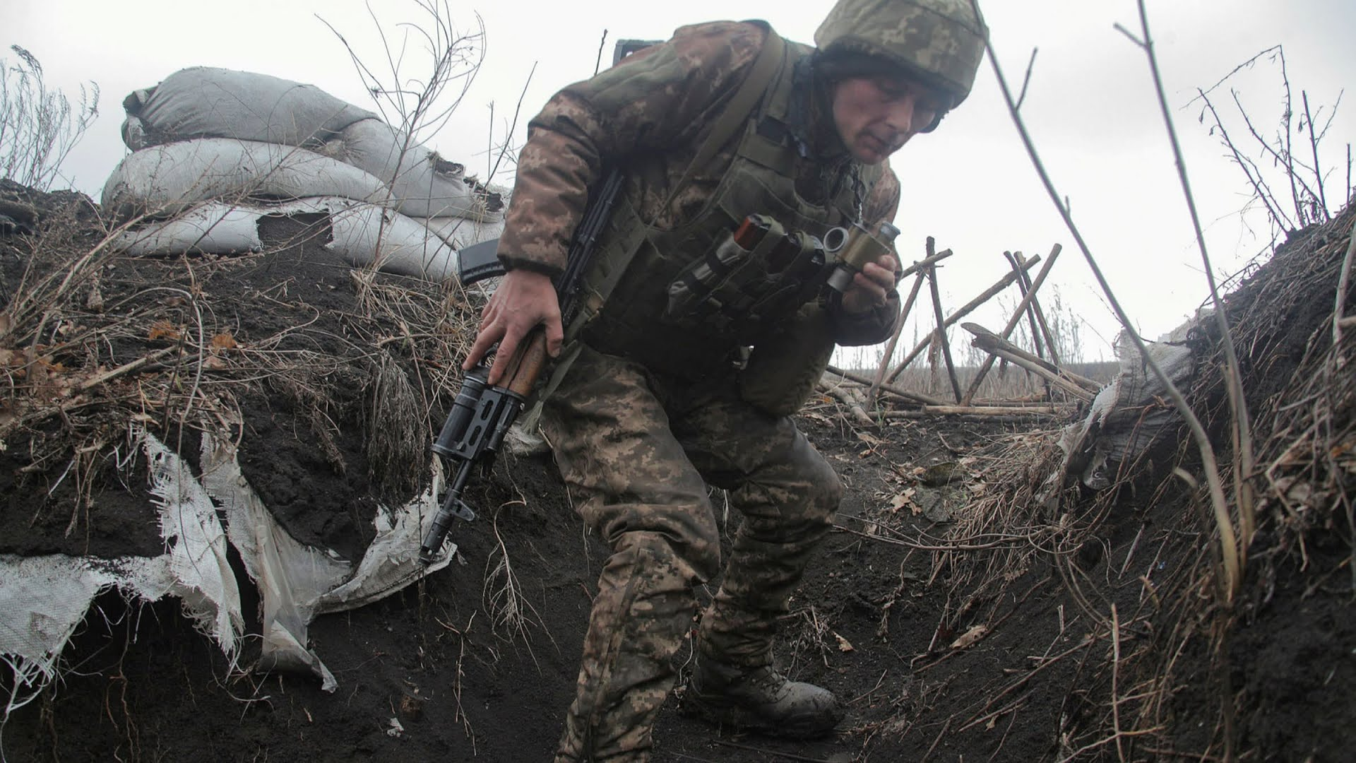 A service member of the Ukrainian armed forces is seen at fighting positions on the line of separation near the rebel-controlled city of Donetsk, Ukraine