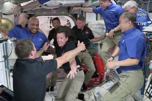 European Space Agency astronaut Thomas Pesquet celebrates with Nasa astronaut Megan McArthur as they and Crew 2 colleagues Jaxa astronaut Akihiko Hoshide of Japan and Nasa's Shane Kimbrough are welcomed by Crew 1 after arriving aboard the International Space Station in April 2021
